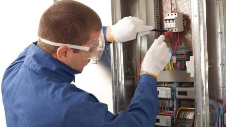 Electrician testing a breaker.