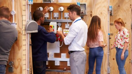 A student attending an electrical training course