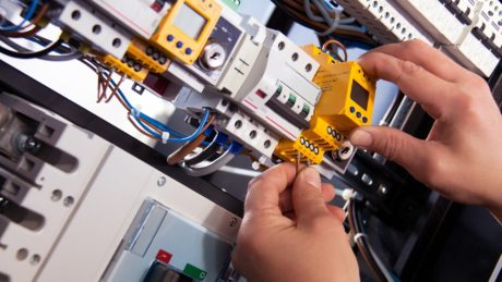 An electrician working on an electrical installation